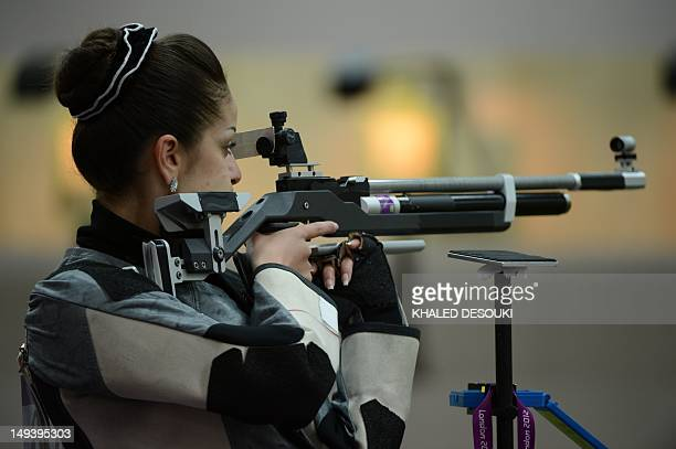 Syria's Raya Zin Aldden competes during the 10m air rifle women's qualification at the London 2012 Olympic Games at the Royal Artillery Barracks in...