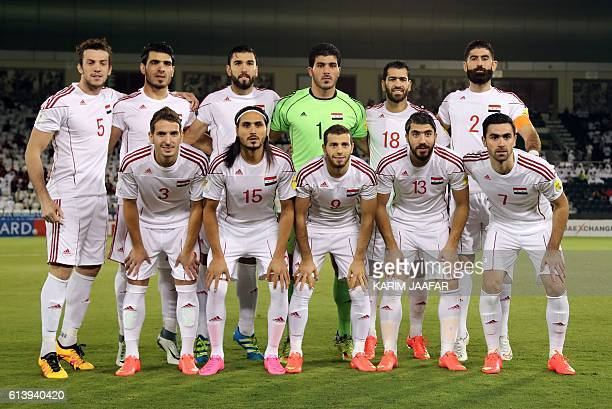 Syria's starting eleven pose for a group picture during the 2018 World Cup qualifying football match between Qatar and Syria at the Jassim Bin Hamad...