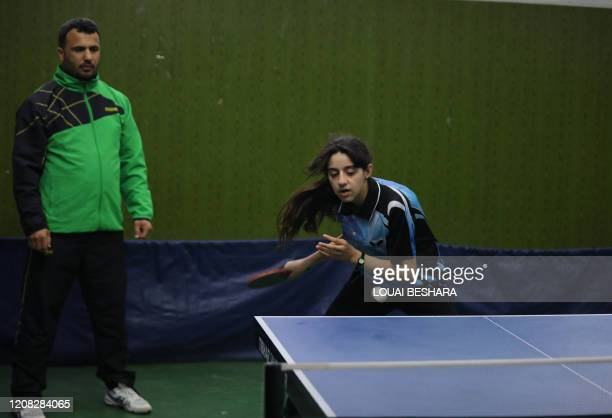 Syrias table tennis player Hind Zaza plays during the local clubs championship in the Syrian capital Damascus on March 13, 2020. - Zaza qualified to...