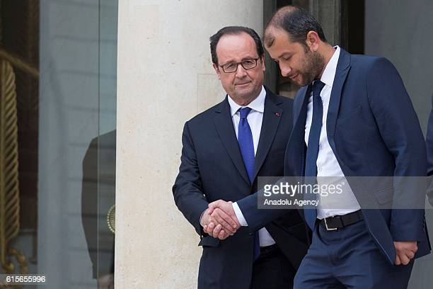Syria's White Helmets leader Raed Saleh shakes hands with French President Francois Hollande after the meeting at the Elysee Palace in Paris France...