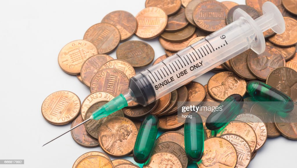 Syringe And Green Capsule Drug On 1 Cent Coins Stack The Symbol Of