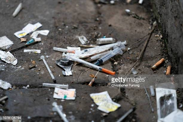 Syringes and paraphernalia used by drug users litter an alley way in Walsall Town Centre on December 06, 2018 in Walsall, England. There were 268,390...
