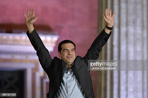 Syriza leader Alexis Tsipras greets supporters following victory in the election in Athens on January 25 2015 Greek Prime Minister Antonis Samaras...