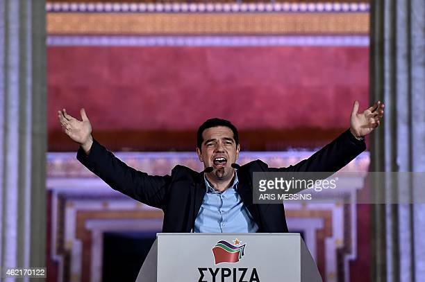 Syriza leader Alexis Tsipras greets supporters following victory in the election in Athens on January 25 2015 The leftwing Syriza party led by Alexis...