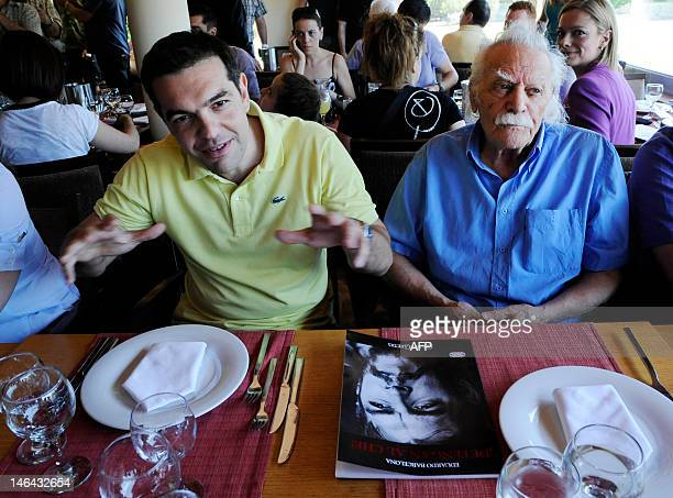 Syriza leftist radical party leader Alexis Tsipras and Greek resistance hero politician and writer Manolis Glezos sit in a restaurant in Athens...