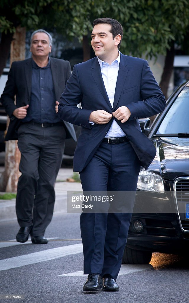Syriza party leader Alexis Tsipras arrives to be sworn in by Greek President Karolos Papoulias as Greece's new Prime Minister at the Presidential Palace on January 26, 2015 in Athens, Greece. Alexis Tsipras was sworn in with a secular oath, rather than the traditional Greek Orthodox ceremony, becoming the youngest man to hold the post of Prime Minister in 150 years. The radical left party Syriza won the snap Greek general election and has asked the right-wing Independent Greek party to form a anti-austerity coalition.