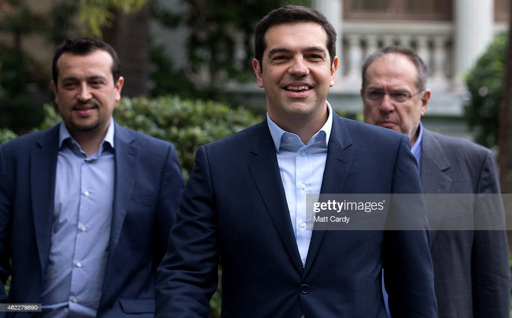 Syriza party leader Alexis Tsipras (C) leaves after being sworn in by Greek President Karolos Papoulias as Greece's new Prime Minister at the Presidential Palace on January 26, 2015 in Athens, Greece. Alexis Tsipras was sworn in with a secular oath, rather than the traditional Greek Orthodox ceremony, becoming the youngest man to hold the post of Prime Minister in 150 years. The radical left party Syriza won the snap Greek general election and has asked the right-wing Independent Greek party to form a anti-austerity coalition.