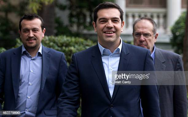 Syriza party leader Alexis Tsipras leaves after being sworn in by Greek President Karolos Papoulias as Greece's new Prime Minister at the...