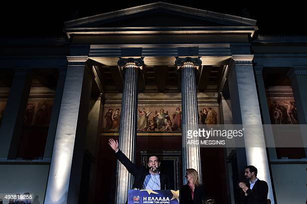 Syriza's leader Alexis Tsipras candidate to head the European Commission for the European Left waves at his supporters after the results of the...