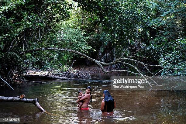 Syroly Awá baths with her son Wy in Juriti Maranhão Brazil on July 31 2015 The Awá are considered among the most endangered tribes in the world The...