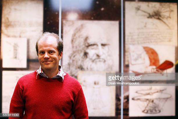 System Engineer David Binns poses in the Systems and Cost Engineering Division / The Concurrent Design Facility in front of Galileo sketches and...