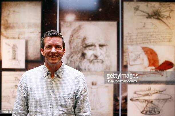 System Engineer Robin Biesbroek poses in the Systems and Cost Engineering Division / The Concurrent Design Facility in front of Galileo sketches and...