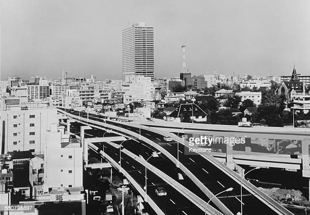 A system of overhead expressways from the centre of Tokyo to the outer areas Japan circa 1980 Motorists are charged tolls for using them