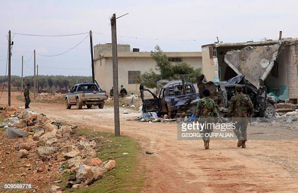 SySyrian government forces patrol after taking control of the village of Kiffin on the northern outskirts of the embattled city of Aleppo on the road...