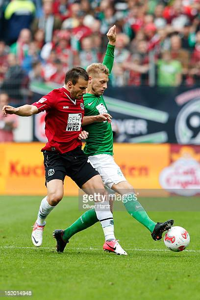 Szabolcs Huszti of Hannover and Aaron Hunt of Bremen battle for the ball during the 1 Bundesliga match between Hannover 96 and Werder Bremen at AWD...