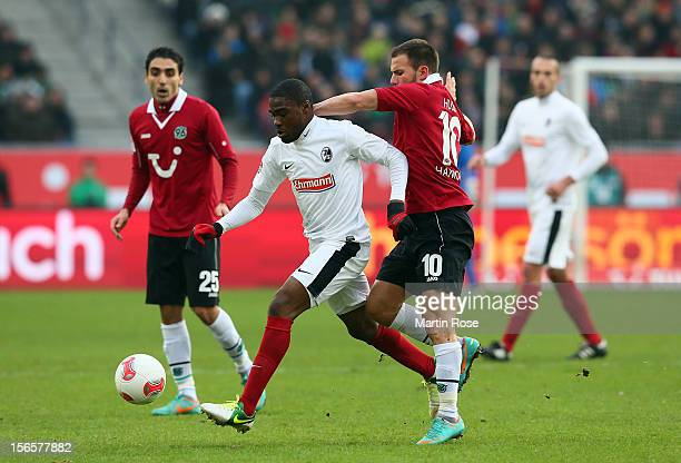 Szabolcs Huszti of Hannover and Cedrick Makiadi Freiburg battle for the ball during the Bundesliga match between Hannover 96 and SC Freiburg at AWD...