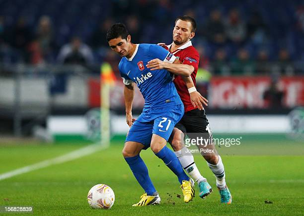 Szabolcs Huszti of Hannover and Felipe Gutierrez of Twente compete for the ball during the UEFA Europa League Group L match between Hannover 96 and...