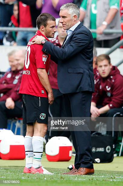 Szabolcs Huszti of Hannover and head coach Mirko Slomka of Hannover during the 1 Bundesliga match between Hannover 96 and Werder Bremen at AWD Arena...