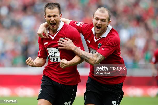Szabolcs Huszti of Hannover celebrates after scoring their first goal with Konstantin Rausch of Hannover during the Bundesliga match between Hannover...