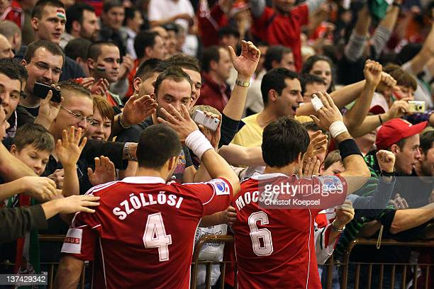 Szabolcs Szoelloesi and Tamas Mocsai Nador Fazekas of Hungary celebrates the 2623 victory with the fans after the Men's European Handball...