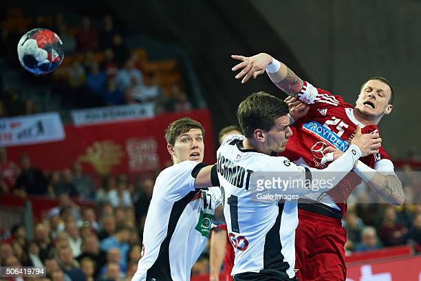 Szabolcs Zubai of Hungary and Erik Schmidt of Germany during the 2 group match of the EHF European Men's Handball Championship between Germany and...