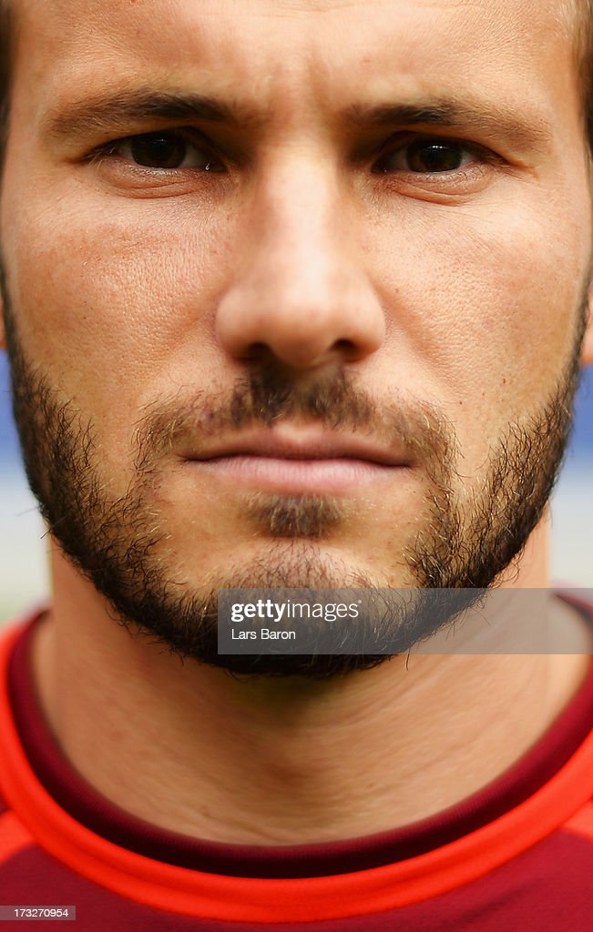 Szabolcz Huszti poses during the Hannover 96 team presentation at HDI Arena on July 11, 2013 in Hanover, Germany.