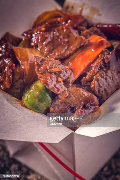 Szechuan beef Served with Rice as Take Out Food
