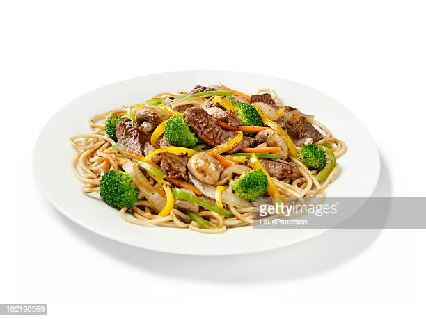 szechuan beef with noodles - stir fried stock pictures, royalty-free photos & images