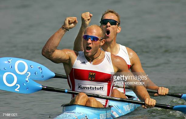 Gold medalist German Ronald Rauhe and Tim Wieskotter celebrate their victory at the finish line on the Matyeri Lake of Szeged 20 August 2006 after...