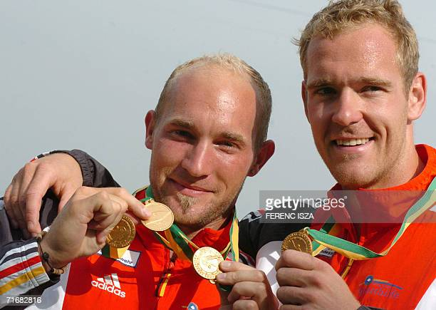 Gold medalists German's Ronald Rauhe and Tim Wieskotter show the medals after the K2 men's medal ceremony at the 35th ICF Flatwater Racing World...