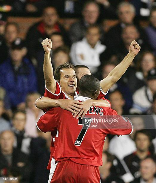 Szilard Nemeth celabrates his goal with George Boetang for Middlesbrough during the Barclays Premiership match between Fulham and Middlesbrough at...