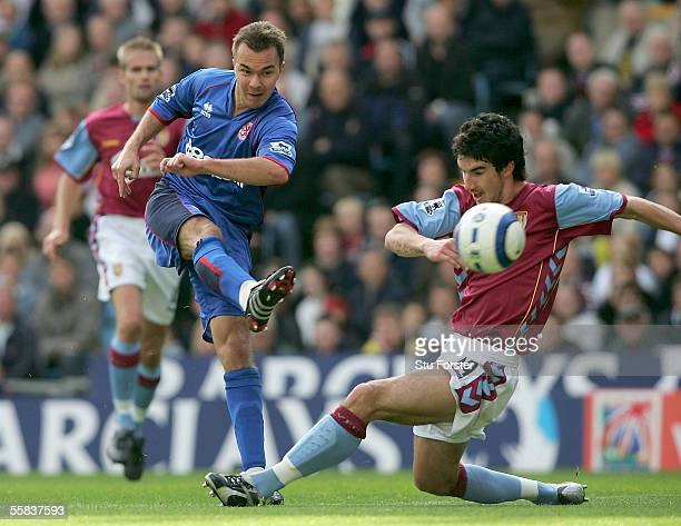 Szilard Nemeth gets in a shot despite the attentions of Liam Ridgewell of Villa during the Barclays Premiership match between Aston Villa and...