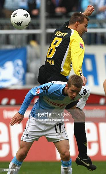Szilard Nemeth of Aachen challenge for the ball with Sven Bender of Munich during the Second Bundesliga match between 1860 Munich and Alemannia...