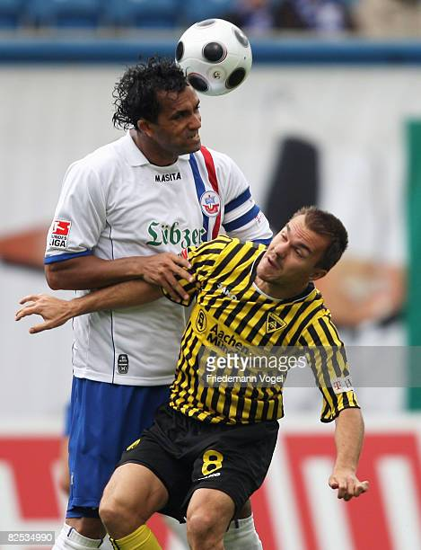 Szilard Nemeth of Aachen challenges Gledson of Rostock for the ball during the Bundesliga match between Hansa Rostock and Alemannia Aachen at the DKB...
