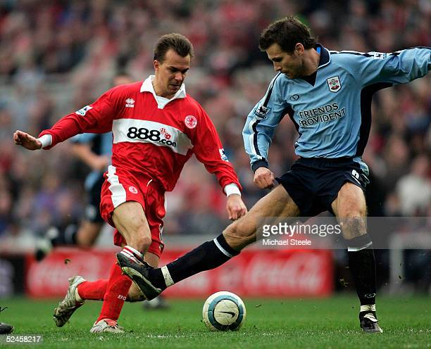 Szilard Nemeth of Middlesbrough drags the ball past Claus Lundekvam during the Barclays Premiership match between Middlesbrough and Southampton at...