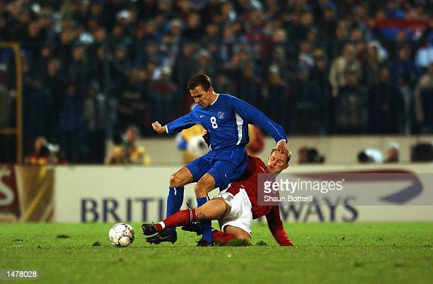 Szilard Nemeth of Slovakia is tackled by Nicky Butt of England during the UEFA European Championship Qualifying Group 7 match between Slovakia and...