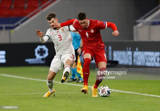 Szilveszter Hangya of Hungary fights for the ball with Dusan Vlahovic of Serbia during the UEFA Nations League group stage match between Hungary and...