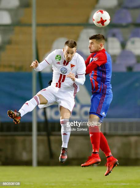 Szilveszter Hangya of Vasas FC battles for the ball in the air with Adam Bodi of DVSC during the Hungarian OTP Bank Liga match between Vasas FC and...
