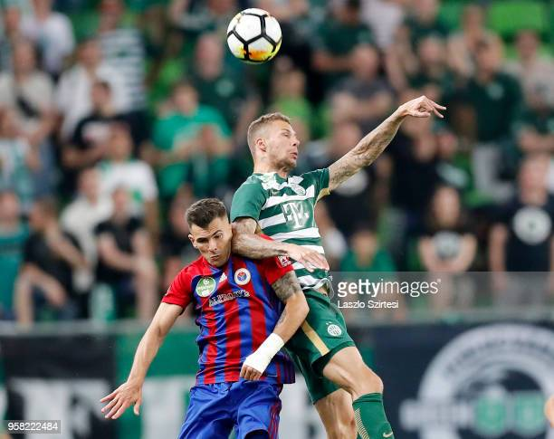 Szilveszter Hangya of Vasas FC battles for the ball in the air with Roland Varga of Ferencvarosi TC during the Hungarian OTP Bank Liga match between...
