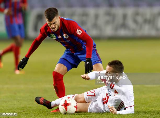 Szilveszter Hangya of Vasas FC competes for the ball with Adam Bodi of DVSC during the Hungarian OTP Bank Liga match between Vasas FC and DVSC at...