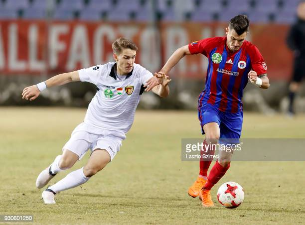 Szilveszter Hangya of Vasas FC wins the ball from Balint Tomosvari of Budapest Honved during the Hungarian OTP Bank Liga match between Vasas FC and...