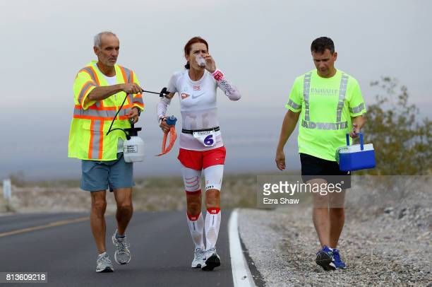 Szilvia Lubics of Hungary is sprayed by a member of her support crew during the STYR Labs Badwater 135 on July 12 2017 in Death Valley California The...