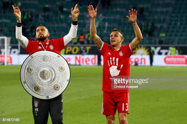 t Arturo Vidal and Rafinha of Bayern celebrate after winning the German Championship after winning 60 the Bundesliga match between VfL Wolfsburg and...