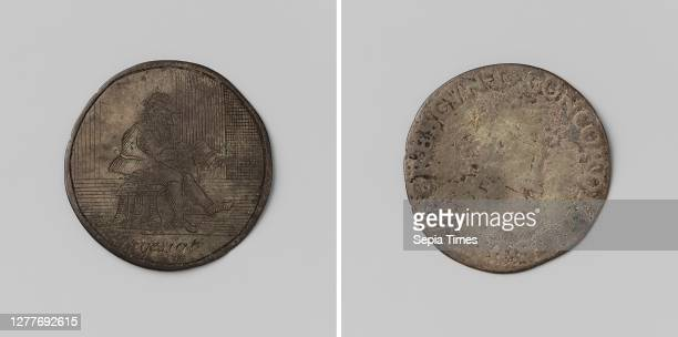T Gesigt, show engraved on a Leicester push, Silver Medal Front: man looking to the right with glasses and hat is reading, cut off: inscription....