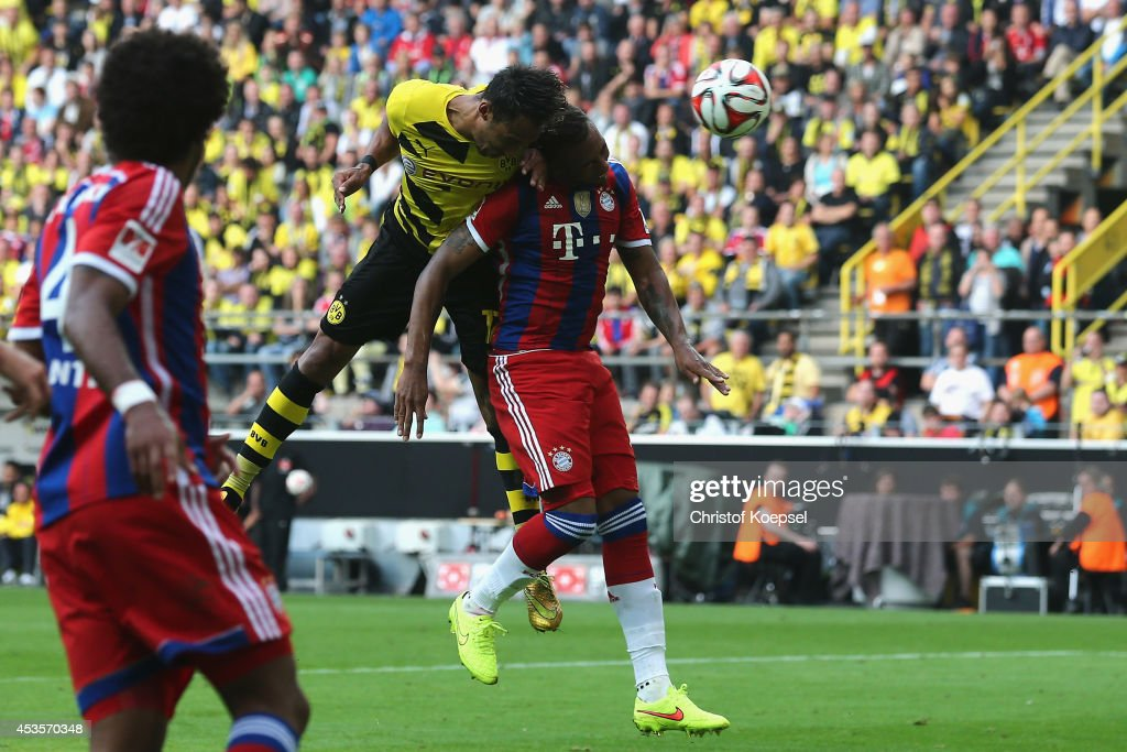 t Pierre-Emerick Aubameyang of Dortmund scores the secodn goal against Jerome Boateng of Bayern Muenchen during the DFL Supercup match between Borussia Dortmund and FC Bayern Muenchen at Signal Iduna Park on August 13, 2014 in Dortmund, Germany.