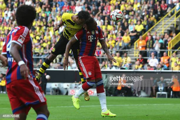 t PierreEmerick Aubameyang of Dortmund scores the secodn goal against Jerome Boateng of Bayern Muenchen during the DFL Supercup match between...