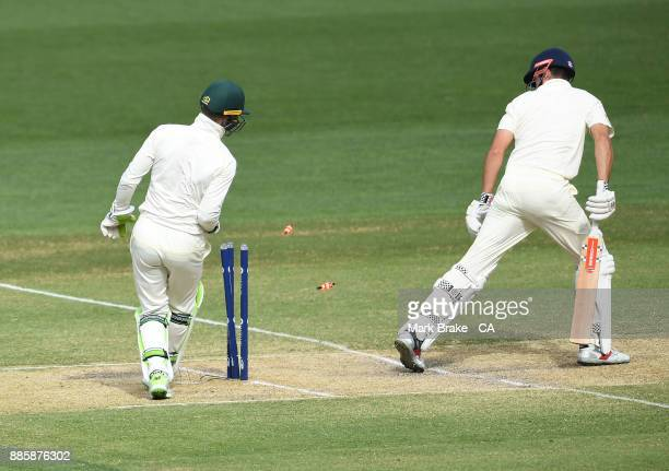 t Tim Paine wicket keeper of Australia takes off the bails to Alastair Cook of Englandduring day four of the Second Test match during the 2017/18...