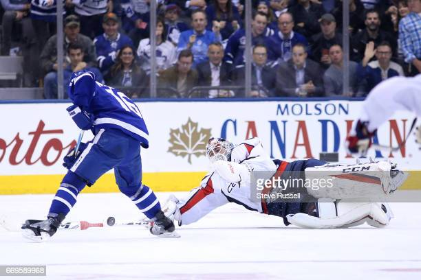 TORONTO ON APRIL 17 t70 leaps to knock the puck away from Mitch Marner far from his net as the Toronto Maple Leafs play the Washington Capitals in...