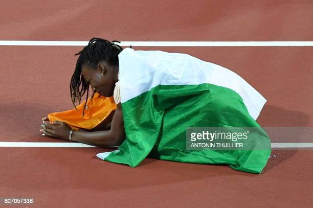 ta Ivory Coast's MarieJosée Ta Lou celebrates after finishing second in the final of the women's 100m athletics event at the 2017 IAAF World...
