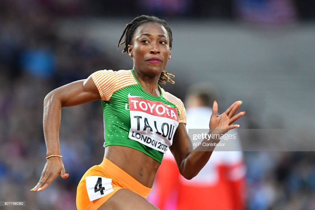 ta Ivory Coast's Marie-Josée Ta Lou competes in the heats of the women's 200m athletics event at the 2017 IAAF World Championships at the London Stadium in London on August 8, 2017. / AFP PHOTO / Andrej ISAKOVIC